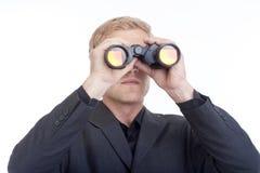 Businessman looking through binoculars Royalty Free Stock Image