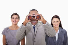 Businessman looking through binoculars Stock Photos