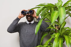 Businessman looking through binoculars Royalty Free Stock Photo