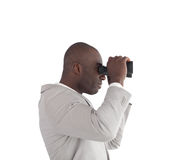 Businessman Looking through binoculars Royalty Free Stock Image