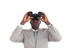 Businessman Looking through binoculars Royalty Free Stock Photos