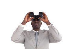 Businessman Looking through binoculars Royalty Free Stock Images