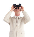 Businessman looking through a binoculars Stock Photos