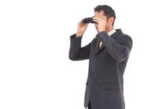 Businessman looking with binoculars Stock Image