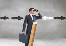 Businessman looking through binoculars while standing on ladder against direction arrows in backgrou Royalty Free Stock Photo