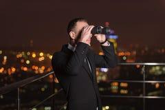 Businessman Looking Through Binoculars Stock Photos