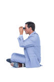 Businessman looking through binoculars Royalty Free Stock Images