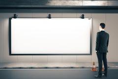 Businessman looking on blank billboard Royalty Free Stock Photos