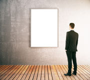 Businessman looking at blank frame Stock Photo
