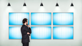 Businessman looking on blank six  tv screen Stock Images
