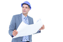Businessman looking at a blueprint Stock Images