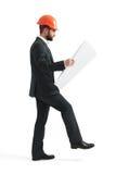 Businessman looking at blueprint Royalty Free Stock Image