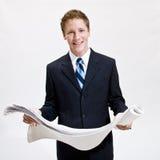Businessman looking at blueprints Stock Photos