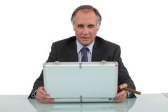 Businessman looking in a briefcase Stock Images