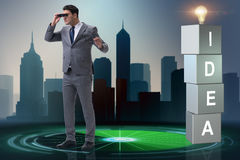 The businessman looking for bright ideas Stock Photo