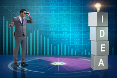The businessman looking for bright ideas Stock Image
