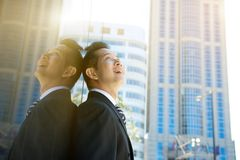 Businessman looking at buildings in the city stock photo
