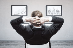 Businessman looking at business charts Royalty Free Stock Photography