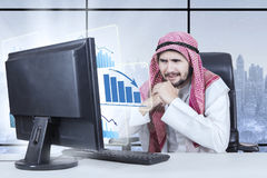 Businessman looking at business graph in winter Royalty Free Stock Photos