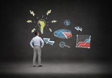 Businessman looking at business idea scheme Stock Photo