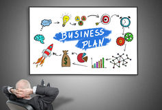 Businessman looking at business plan concept Royalty Free Stock Image