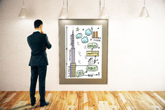 Businessman looking at business sketch Stock Images