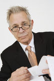 Businessman Looking At Calculator Paper Royalty Free Stock Image
