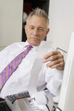 Businessman Looking At Calculator Paper Royalty Free Stock Images