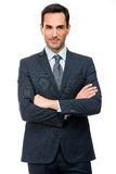 Businessman looking at camera with crossed arms Royalty Free Stock Photo