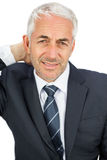 Businessman looking at camera touching his painful neck Royalty Free Stock Photo
