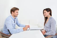 Businessman looking at candidate during interview Stock Photo