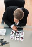 Businessman Looking At Candidates Photograph Stock Photo