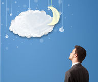 Businessman looking at cartoon night clouds with moon Royalty Free Stock Photography