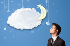 Businessman looking at cartoon night clouds with moon Stock Photography