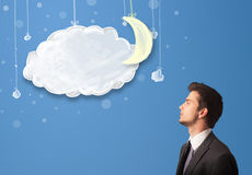 Businessman looking at cartoon night clouds with moon Royalty Free Stock Photos