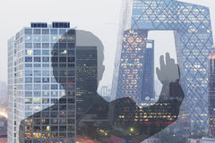 Businessman looking at CCTV building in Beijing, Double exposure Royalty Free Stock Images