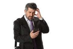 Businessman Looking at Cellphone Stock Photo