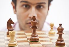 Businessman looking at chess Stock Image