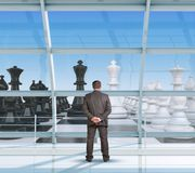 Businessman looking at chess Stock Photo