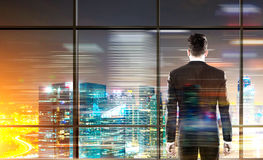 Businessman looking at city Stock Images