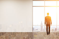 Businessman looking at city. Businessman looking at big city panorama and thinking about his company's future development. Concept of tough decision. 3d Stock Photography