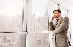 Businessman looking at city from his office Royalty Free Stock Photography