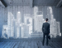 Businessman looking on city sketch. Businessman in wooden room looking on creative city sketch. 3D Rendering Royalty Free Stock Photography