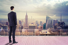 Businessman  looking at city Stock Photo
