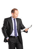 Businessman looking at a clipboard Royalty Free Stock Images