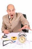 Businessman looking at clock alarm Royalty Free Stock Photography