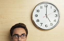 Businessman Looking At Clock On Wooden Wall Stock Photos