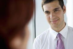 Businessman looking at co-worker Stock Photos