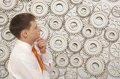 Businessman looking at cogwheels Royalty Free Stock Photo