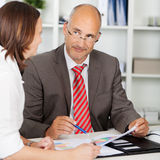 Businessman looking at colleague in meeting Stock Images